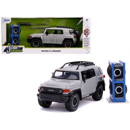 """Toyota FJ Cruiser with Roof Rack Gray with Extra Wheels """"Just Trucks"""" Series 1/24 Diecast Model Car by Jada"""