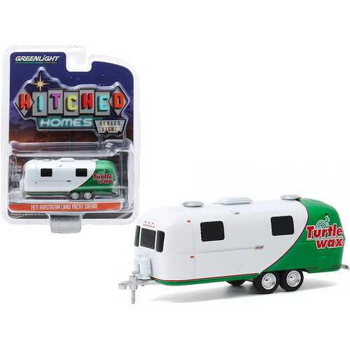 """1971 Airstream Double-Axle Land Yacht Safari Travel Trailer """"Turtle Wax"""" White and Green """"Hitched Homes"""" Series 8 1/64 Diecast Model by Greenlight"""