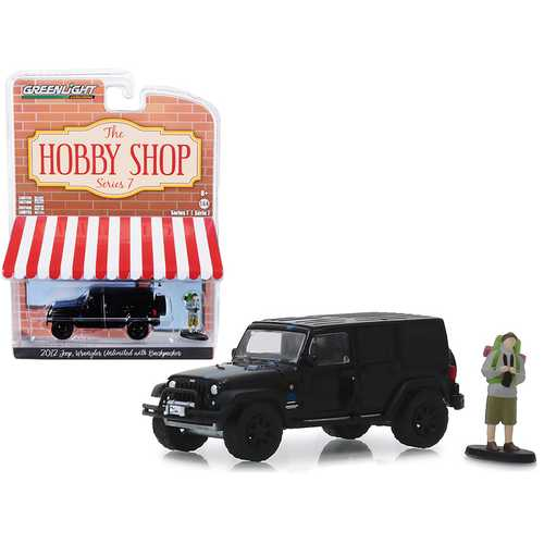 "2012 Jeep Wrangler Unlimited ""MOPAR"" Off-Road Black with Backpacker Figurine ""The Hobby Shop"" Series 7 1/64 Diecast Model Car by Greenlight"