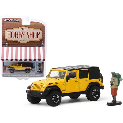 """2015 Jeep Wrangler Unlimited Rubicon Hard Rock Yellow with Black Top and Backpacker Figurine """"The Hobby Shop"""" Series 8 1/64 Diecast Model Car by Greenlight"""