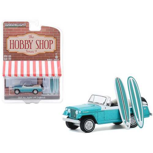 """1968 Jeep Jeepster Aquamarine Metallic with Two Surfboards """"The Hobby Shop"""" Series 9 1/64 Diecast Model Car by Greenlight"""