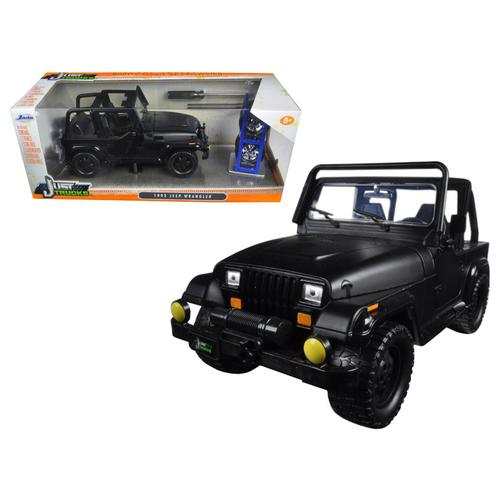 "1992 Jeep Wrangler ""Just Trucks"" with Extra Wheels Matt Black 1/24 Diecast Model Car by Jada"