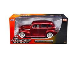 "1939 Chevrolet Master Deluxe Red with baby Moon Wheels ""Showroom Floor"" 1/24 Diecast Model Car by Jada"