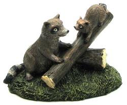 Resin Raccoons on Log