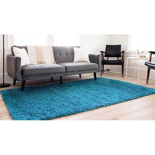 Solid Shag Collection Modern Plush Turquoise Shag Area Rug 3 ft. by 5 ft.