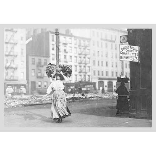 Immigrant Woman Walks Down Street Carrying a Pile of Clothing on Her Head (Paper Poster)