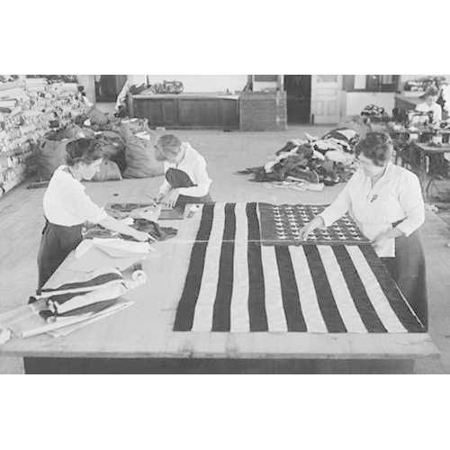 Flags laid out on cutting table to be sewn by Seamstresses who will make American ensigns during the period of the Great War (Canvas Art)