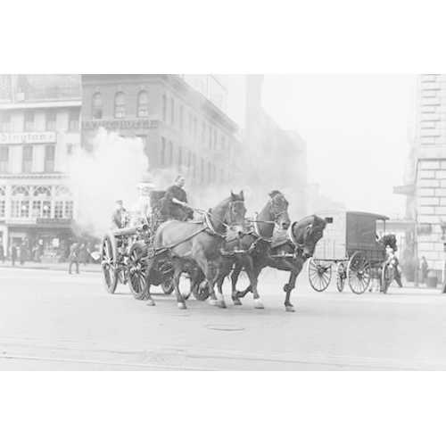 A Team of Horses pulls a steam pumper across paved streets toward a fire scene. (Canvas Art)