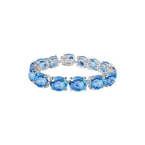 14K White Gold Prong Set Oval Blue Topaz Bracelet with 50.00 CT TGW