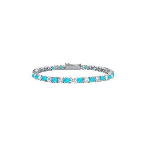 Blue Topaz and Cubic Zirconia Prong Set 10K White Gold Tennis Bracelet 3.00 CT TGW