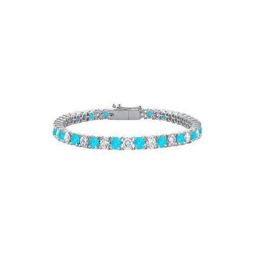 Blue Topaz and Cubic Zirconia Prong Set 10K White Gold Tennis Bracelet 7.00 CT TGW