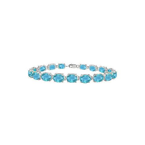 14K White Gold Prong Set Oval Blue Topaz Bracelet with 15.00 CT TGW